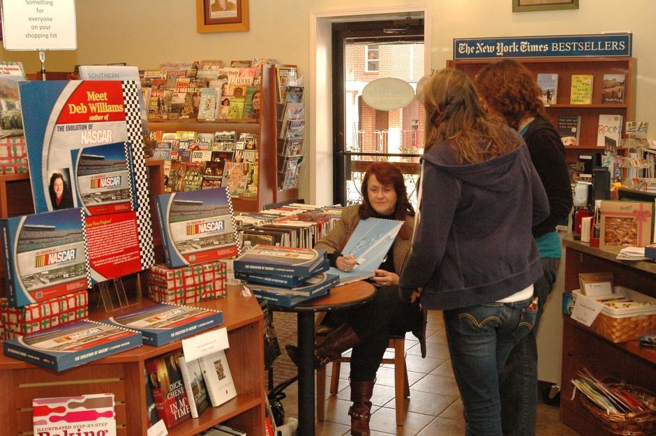 Deb Williams signing books